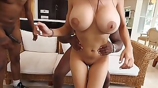 Busty ebony Anita Noir sucks off a monster ball