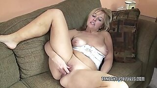 Busty mature playing with a huge dildo
